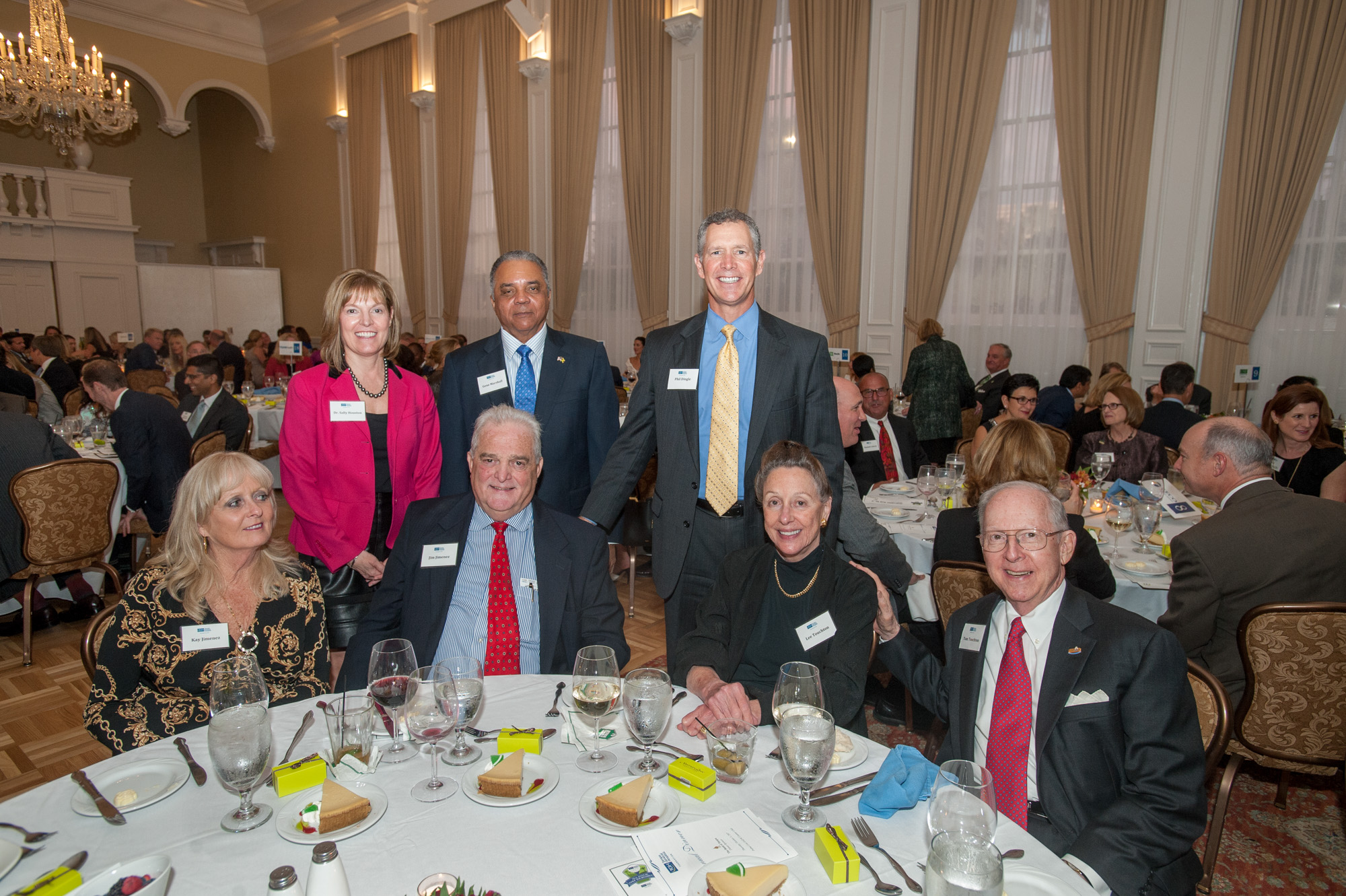 Group photo of patrons at their table during the TGH Foundation dinner.