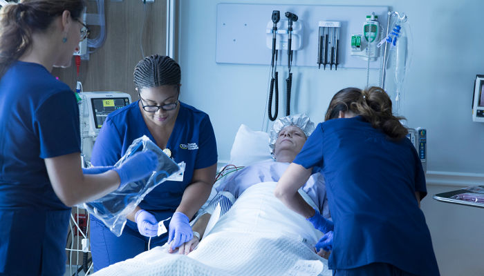 Nurses attend to a transplant patient