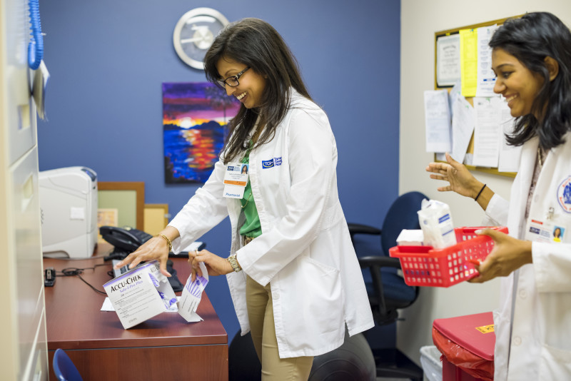 Pharmacy staff work together in office