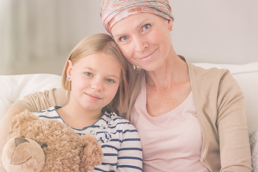 Woman with cancer sitting with her daughter