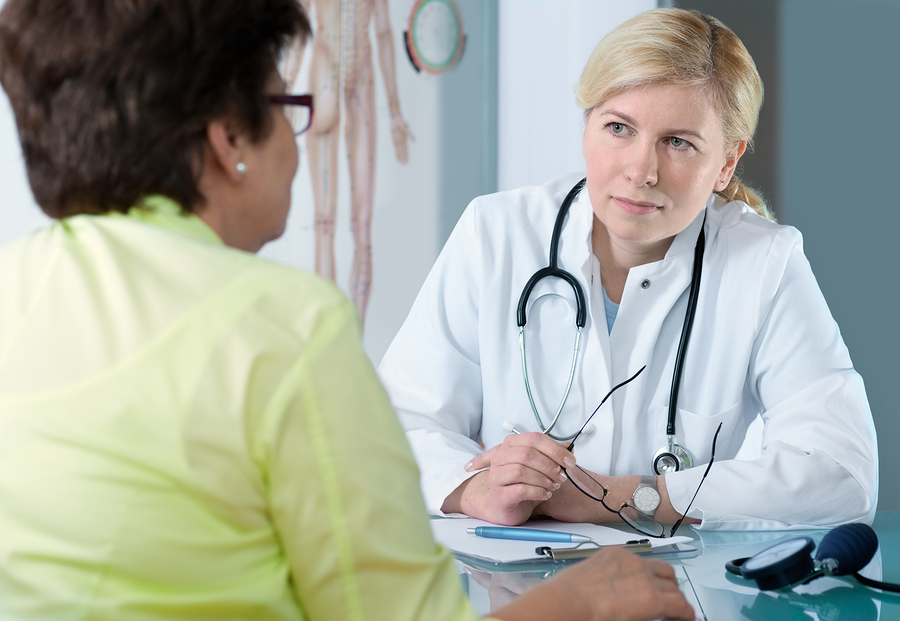 Female physician talking with a female patient