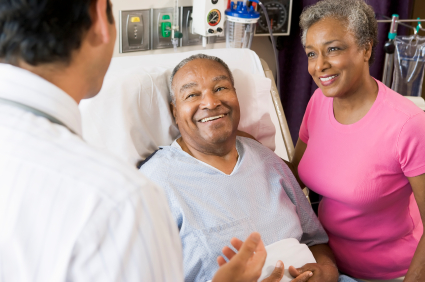Male patient smiling at a male physician