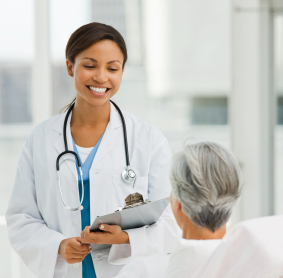 Woman physician smiling at a male patient