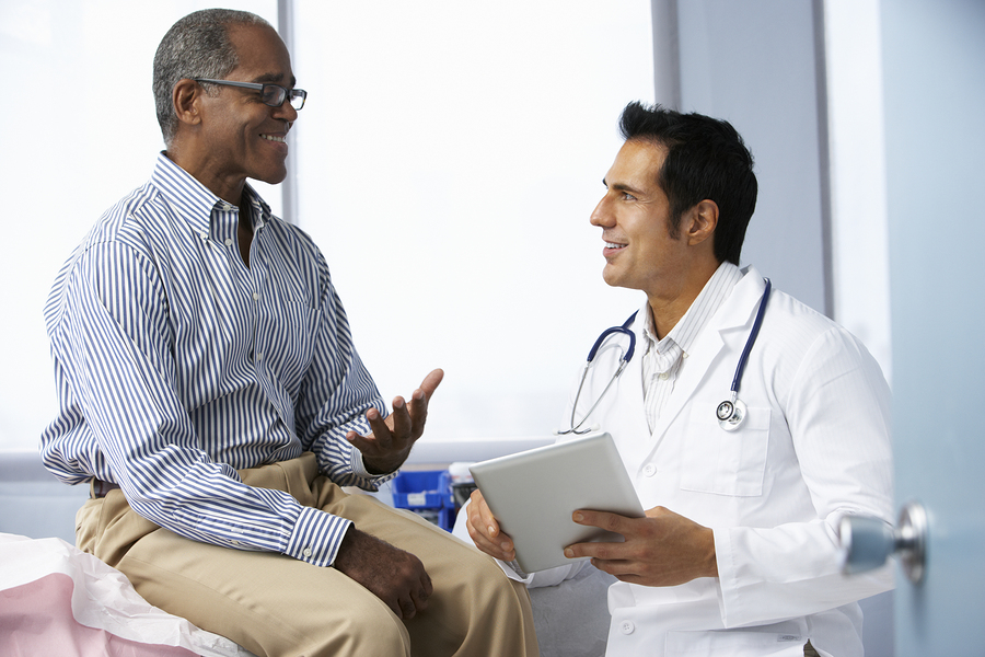 Physician talking with a male patient