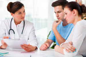 Oncology doctor discussing nasal cancer treatment options with a patient and their partner