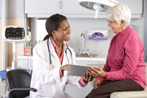 Breast cancer doctor discussing treatment options with a patient