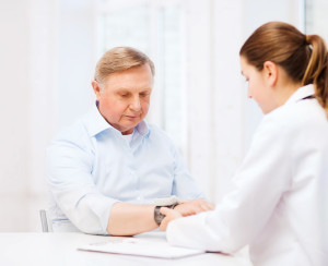 Cancer doctor performing a test on a patient
