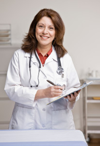 Physician posing for the camera with clipboard in hand