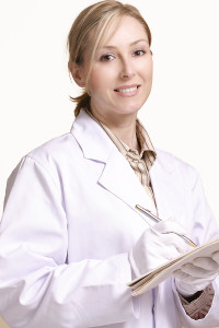 Smiling female cancer doctor taking notes