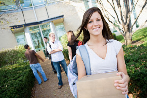Young woman moving into college