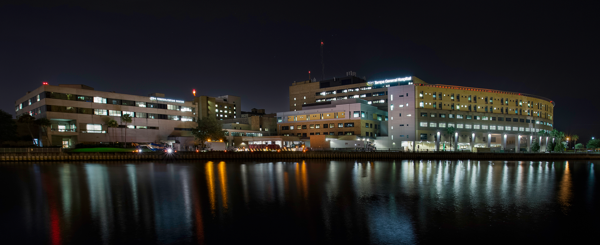 Tampa General Hospital night time over the bay