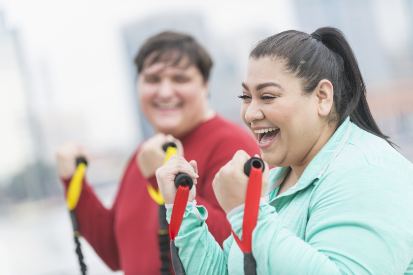 Two people working out and smiling
