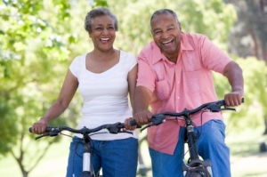 Husband and wife riding bicycle