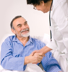 Male patient shaking the hand of a physician