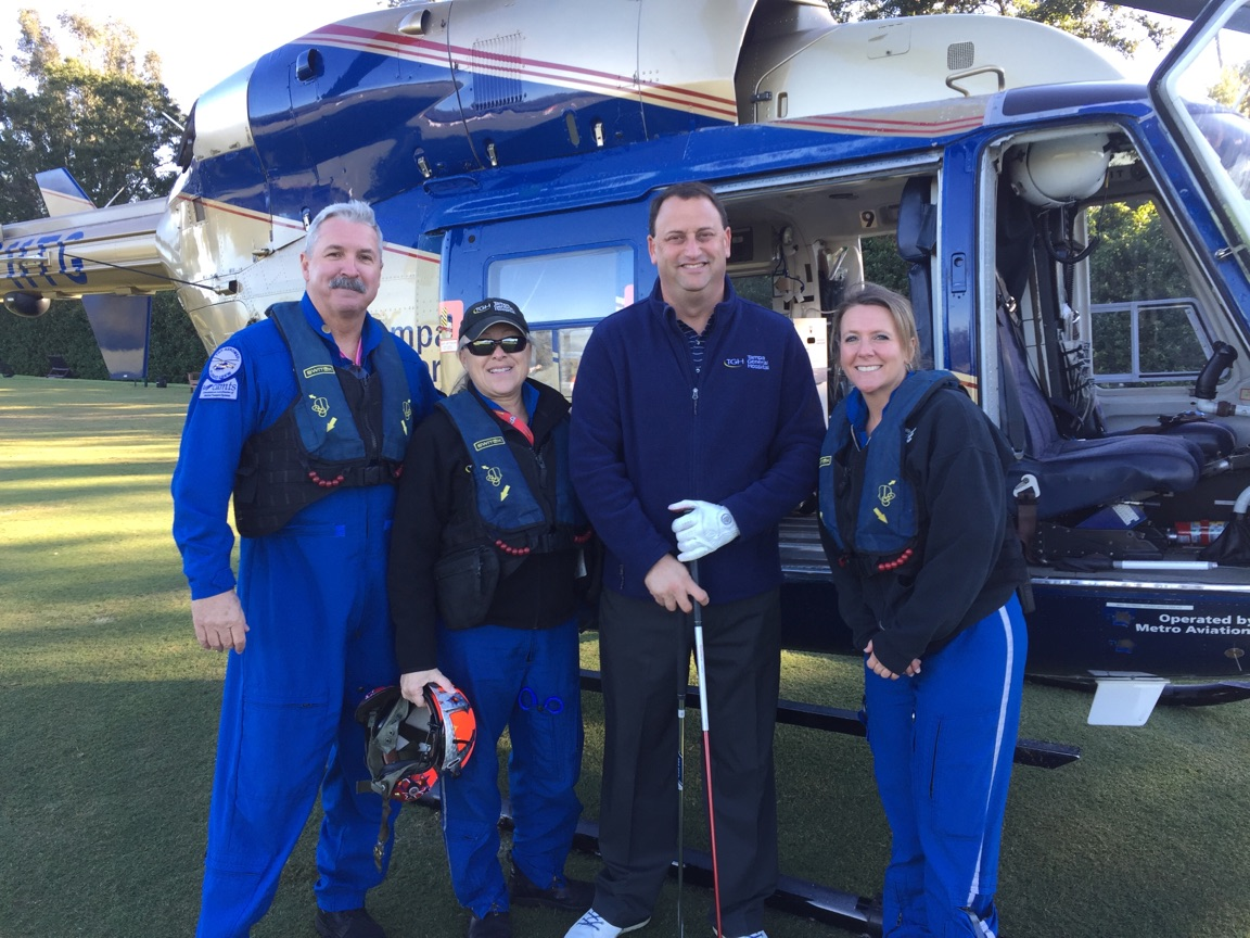 The TGH Aeromed Crew with TGH CEO John Couris prior to taking off with over 600 golf balls to drop on the fairway.