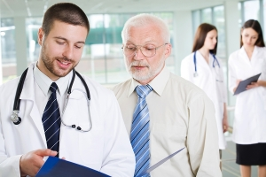 Physicians talking over a medical chart