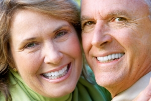 Middle aged couple smiling at camera