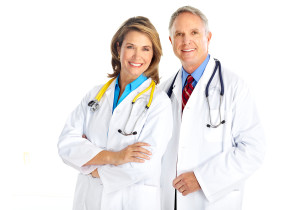 Smiling doctors standing next to each other