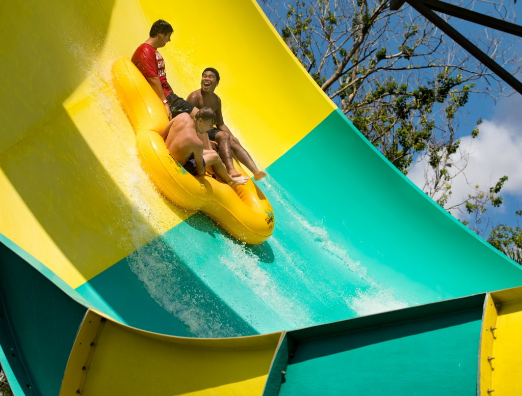 Three boys on a water slide
