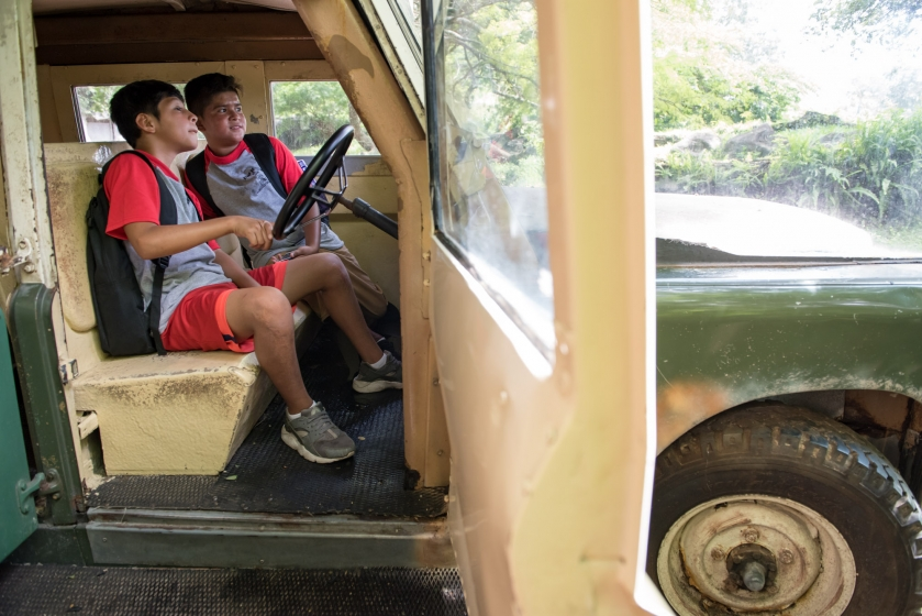 Two boys in a truck at Camp Hopetake