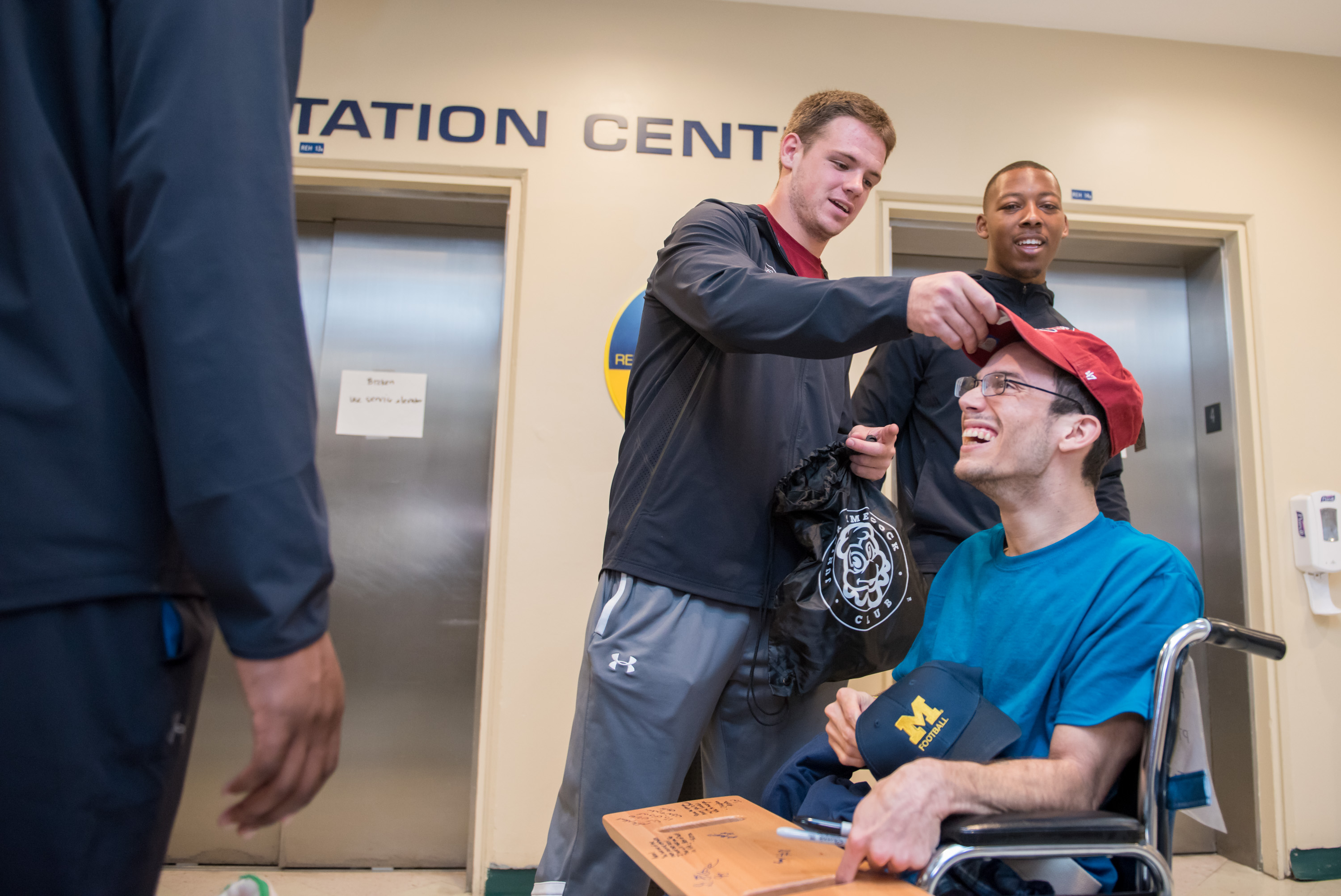 Outback bowl players visits male patient
