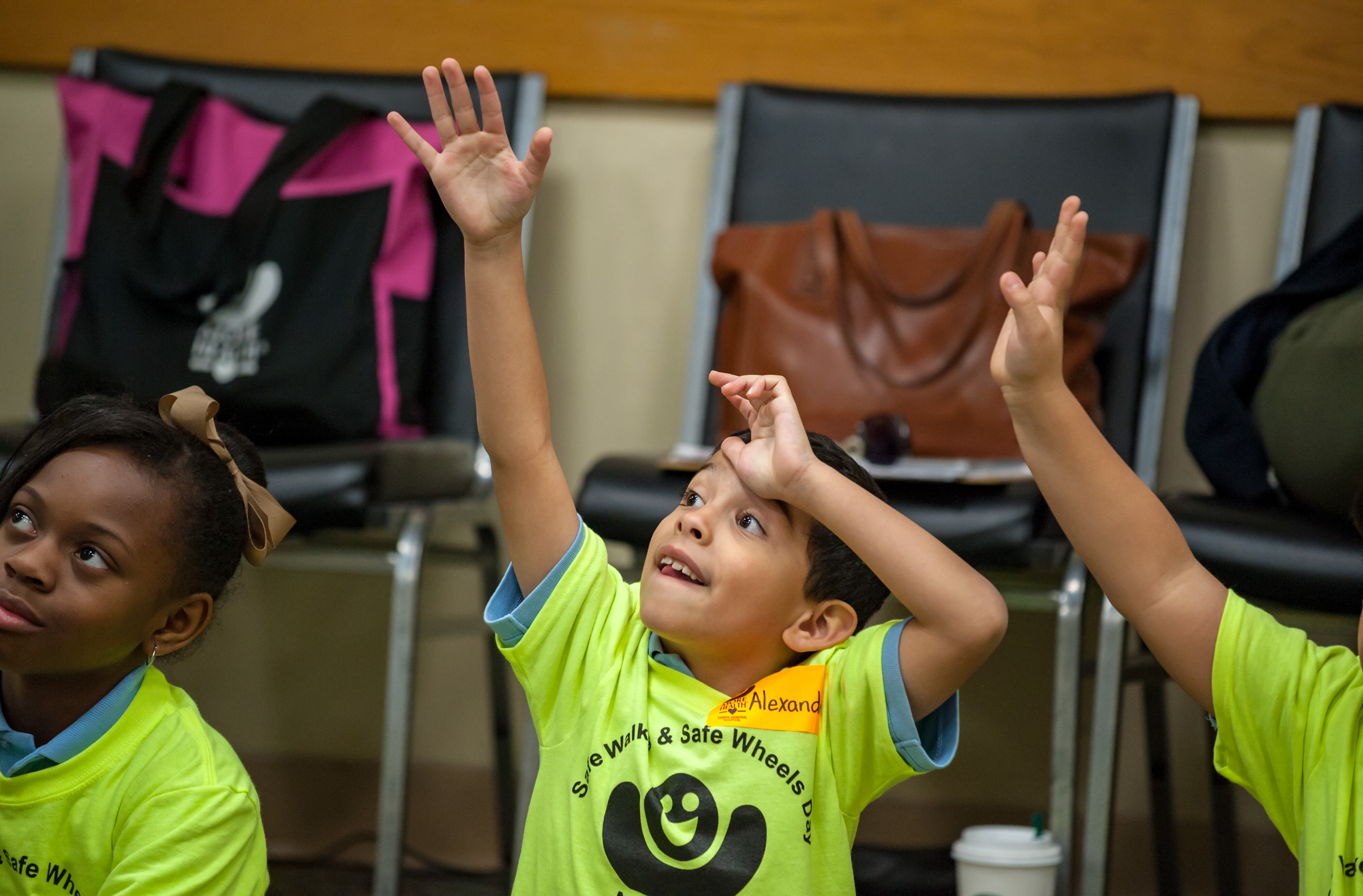 Group of kids raising their hands