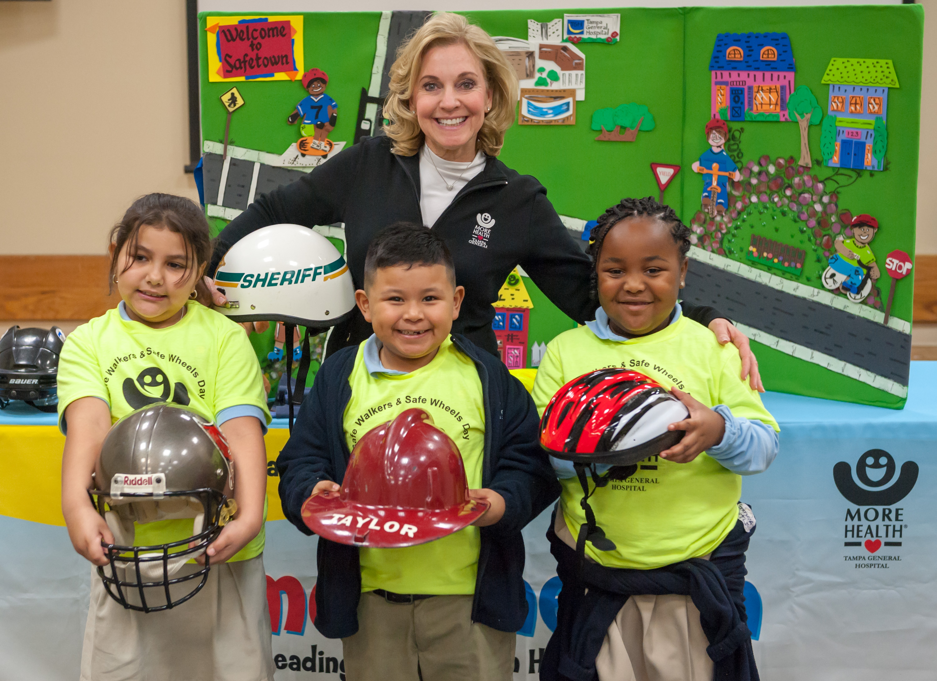 Group of kids and instructor with helmets at More Health