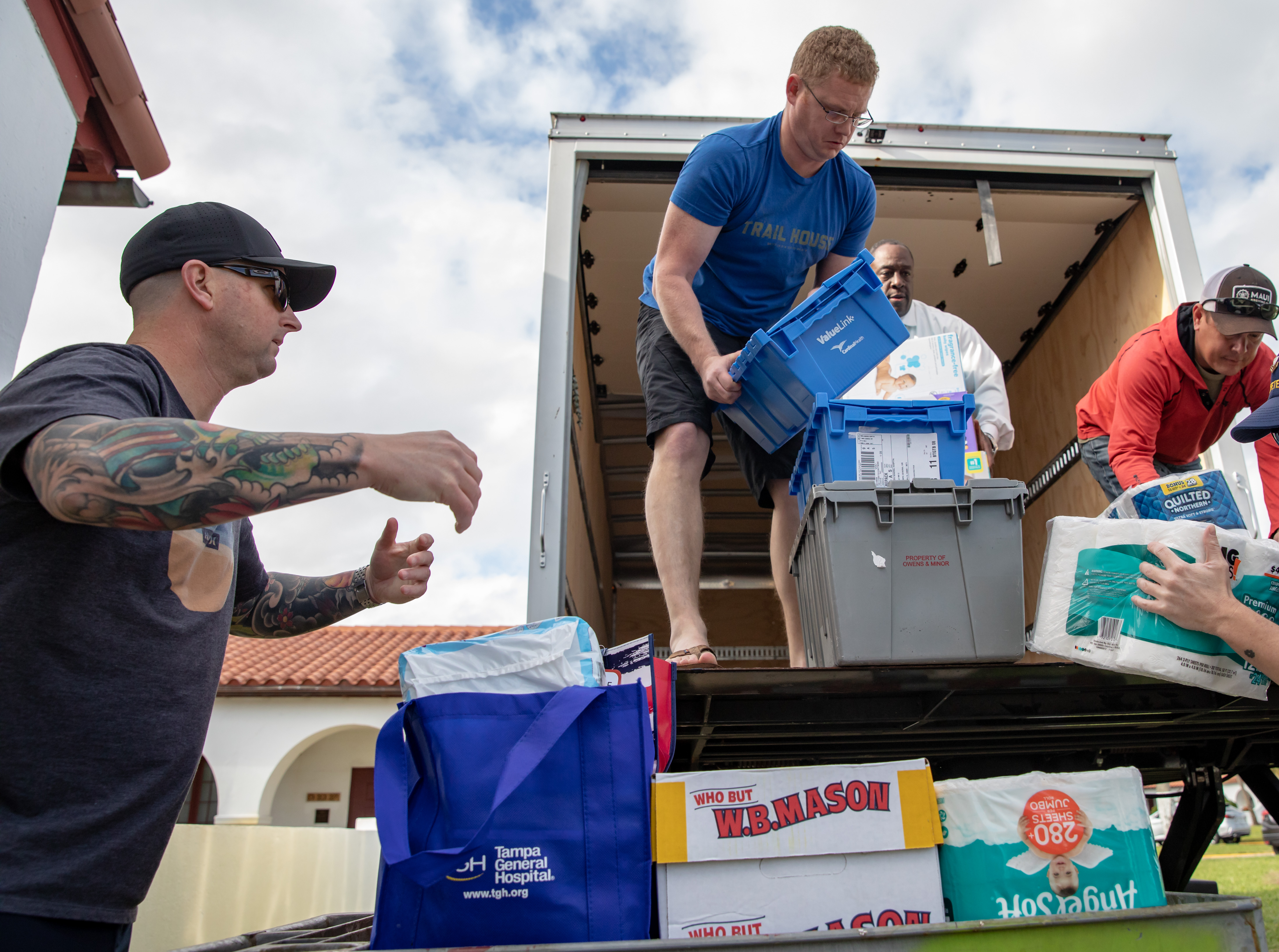 The donated goods arrive at the U.S. Coast Guard Base in St. Petersburg.