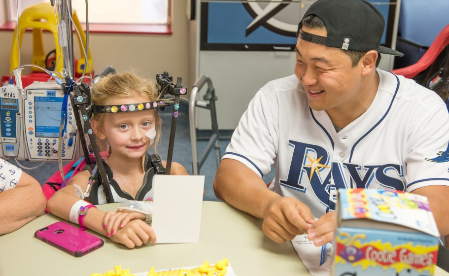 Rays Catcher Hank Conger sits with a patient as he visits Tampa General Hospital.
