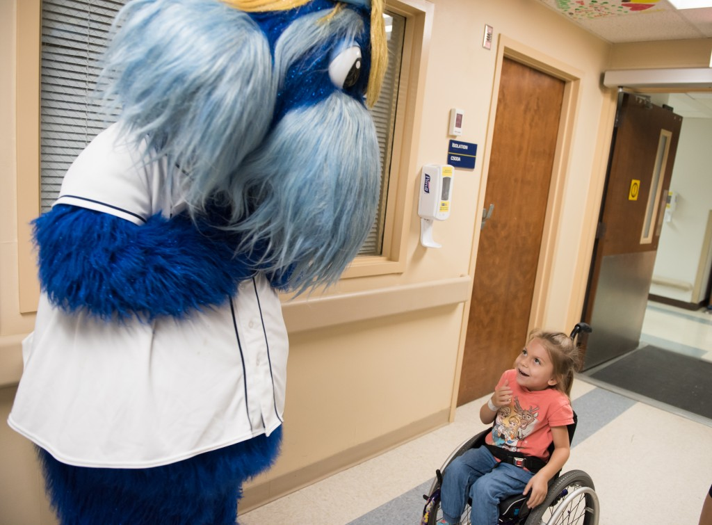 Rays mascot Raymond plays with a patient at Tampa General Hospital.