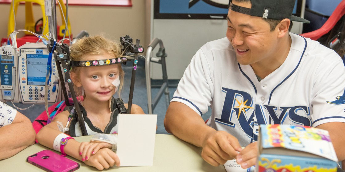 Rays Catcher Hank Conger visits with a patient at Tampa General Hospital.
