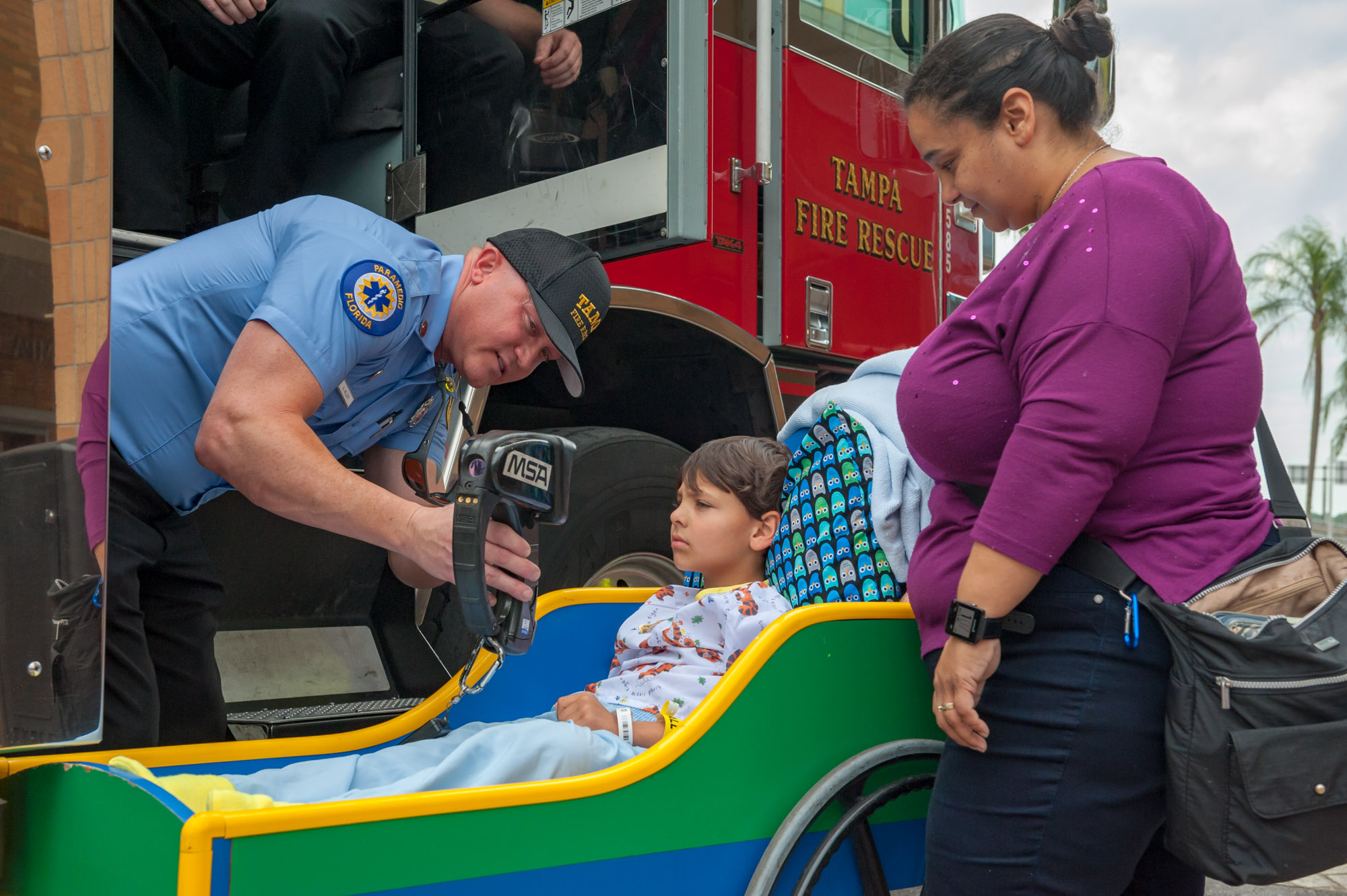 Firefighters from Tampa Fire Rescue delivering toys to pediatric patients