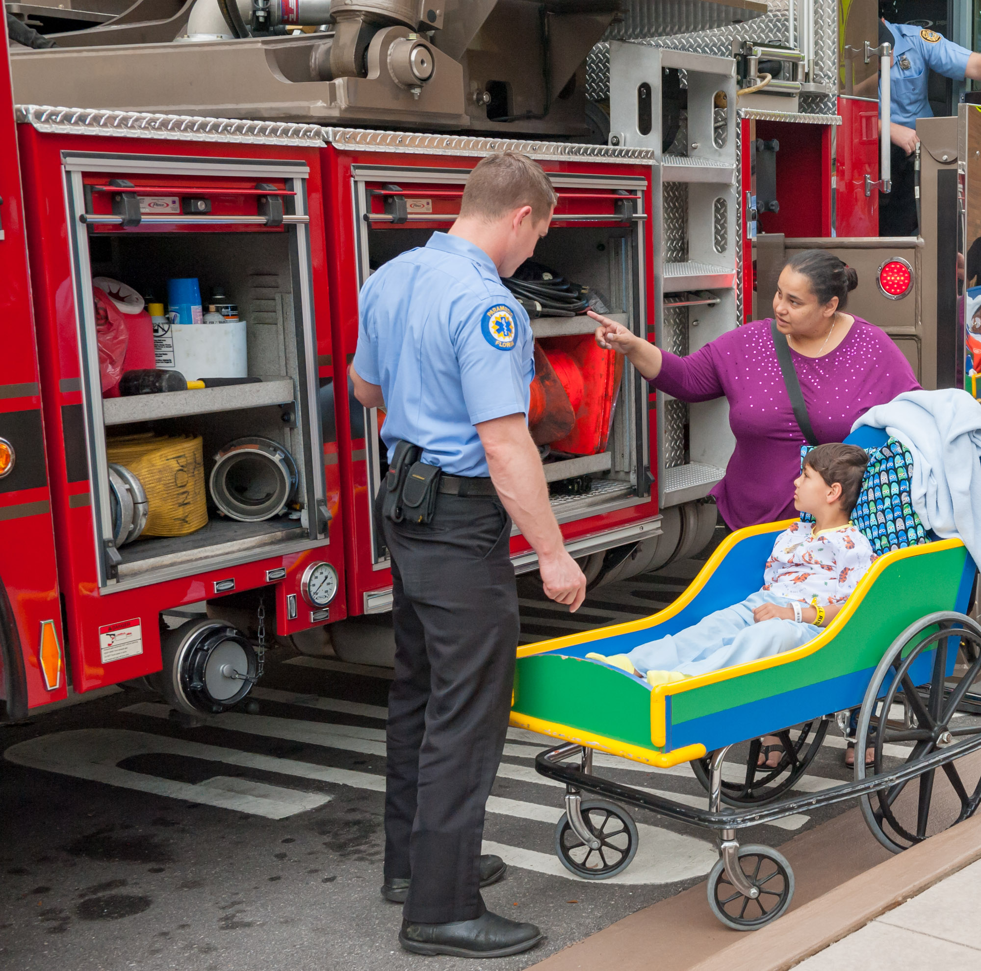Young male patient getting a tour of the firetruck