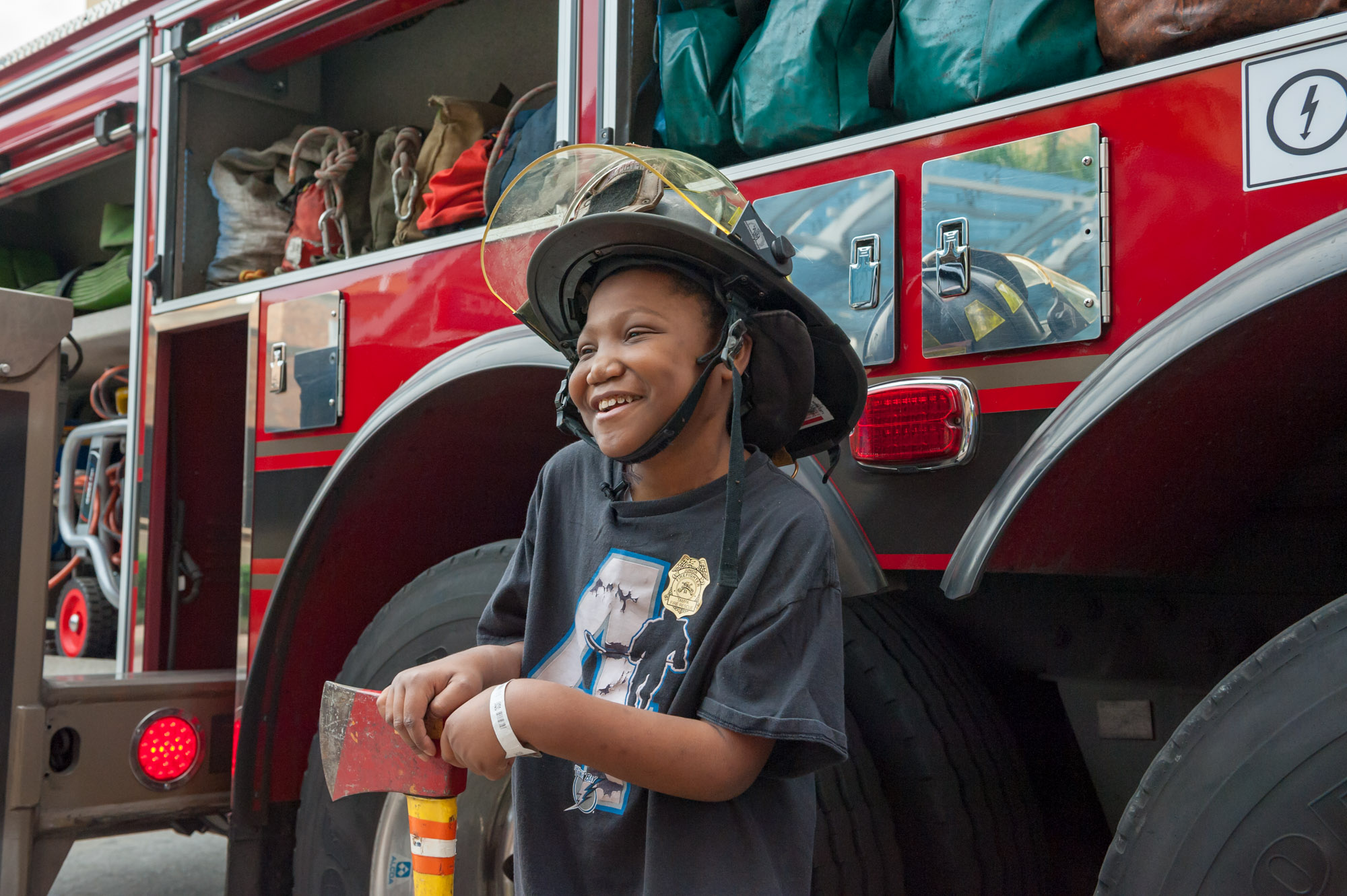 Young male patient trying on the firefighters hat