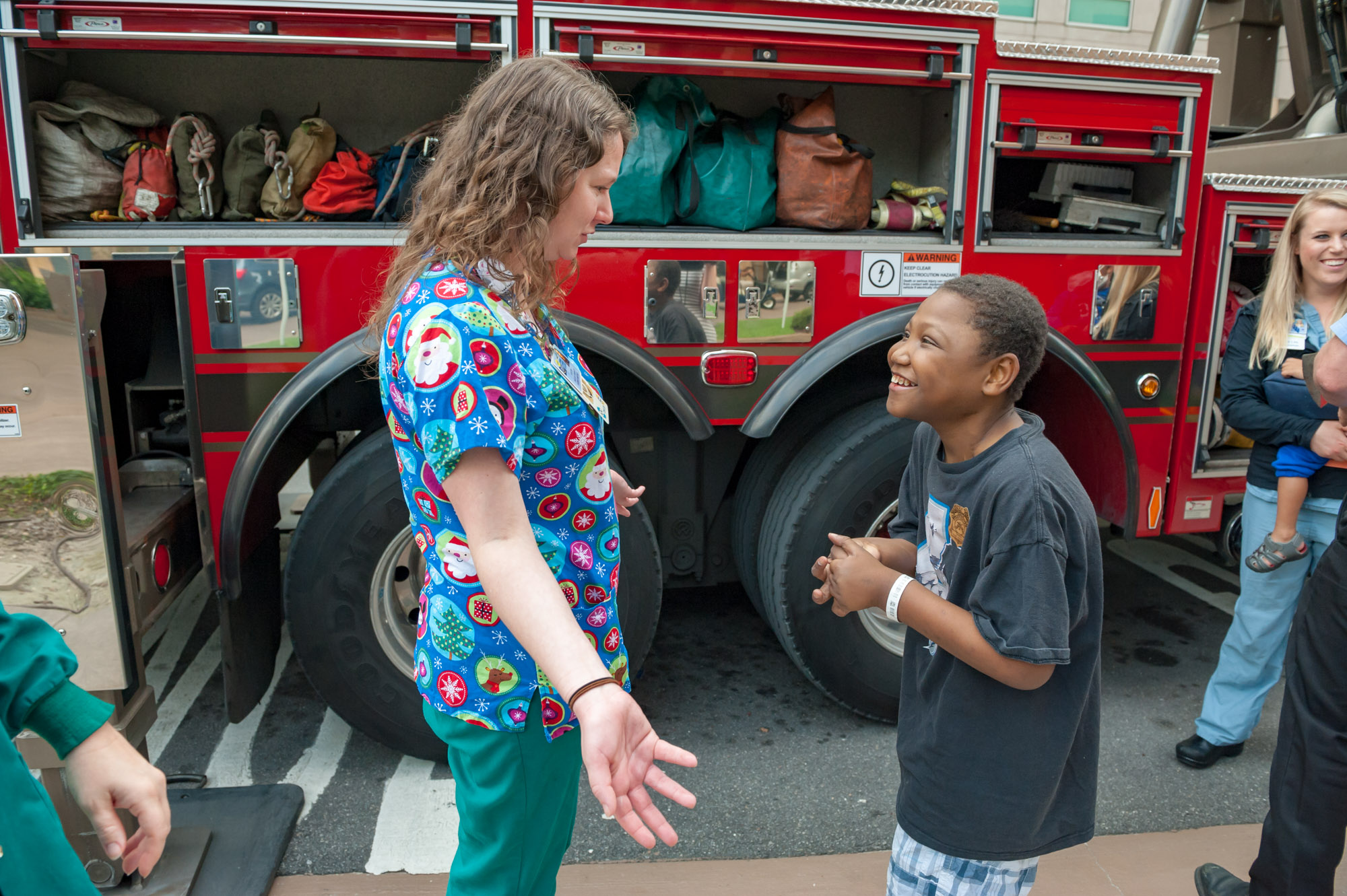 Young male patient talking with a female physician about the firetruck