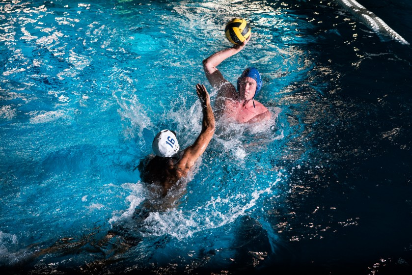 Two men playing water polo