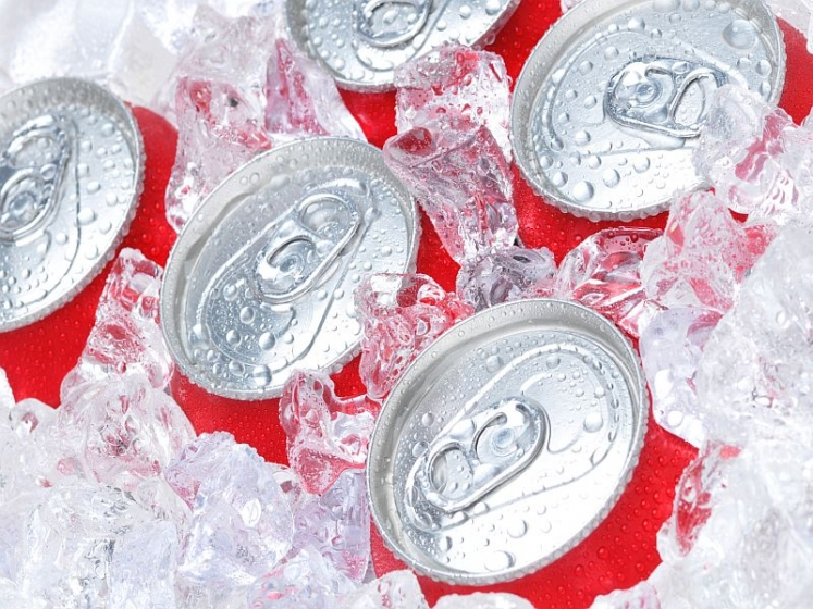 Five soda cans in ice