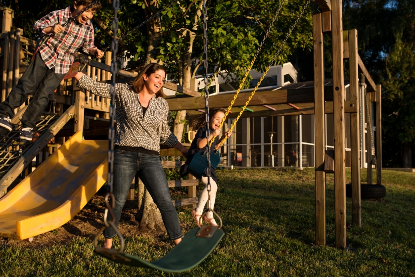 Family playing on the playground