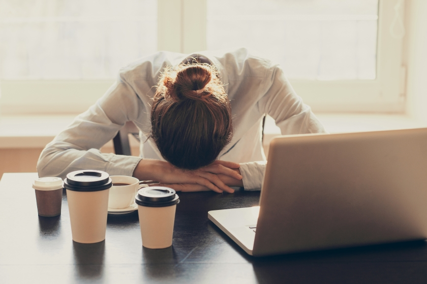 Woman sleeping in the office