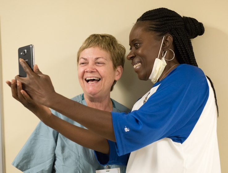 Female transplant patient taking a selfie with a female physician