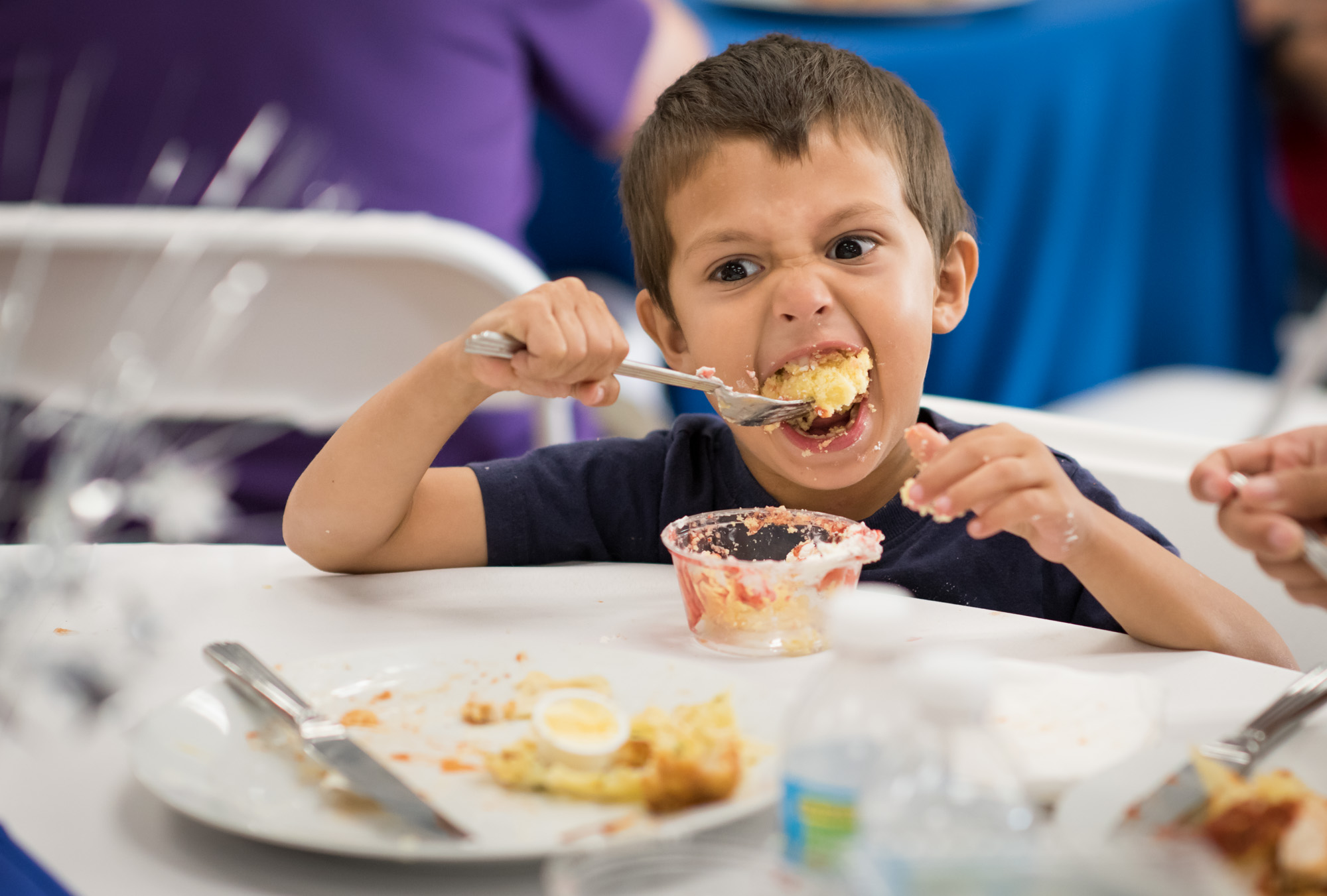 A young boy eating dessert at the trauma awareness luncheon