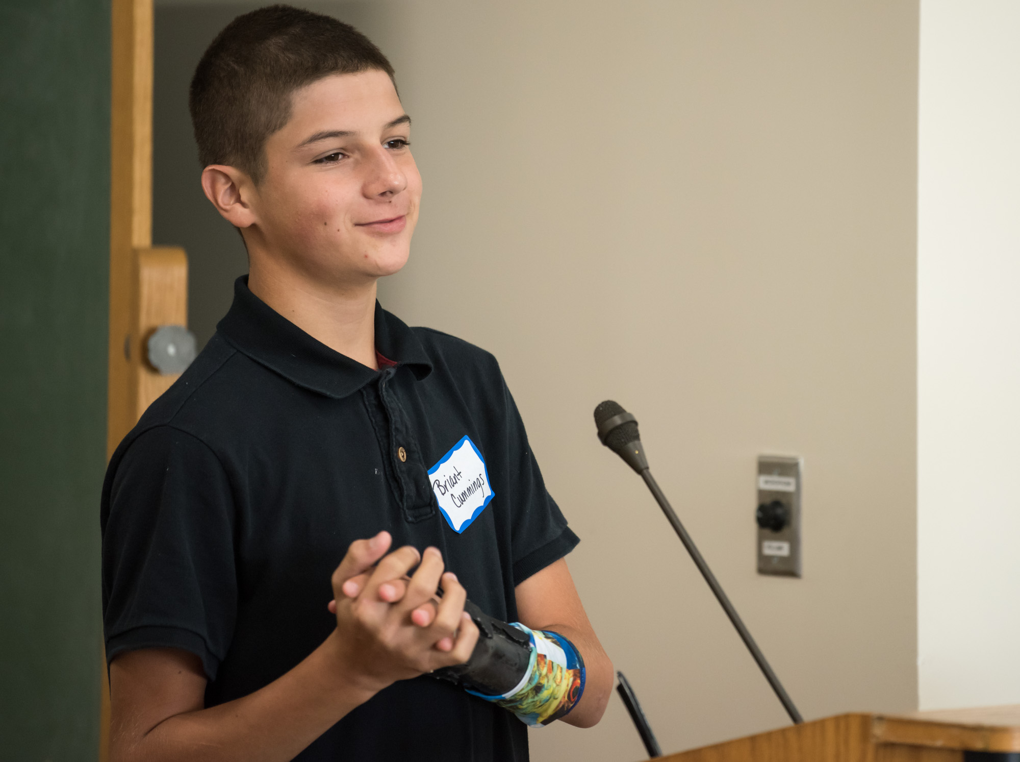 A young male patient talking at the trauma awareness luncheon
