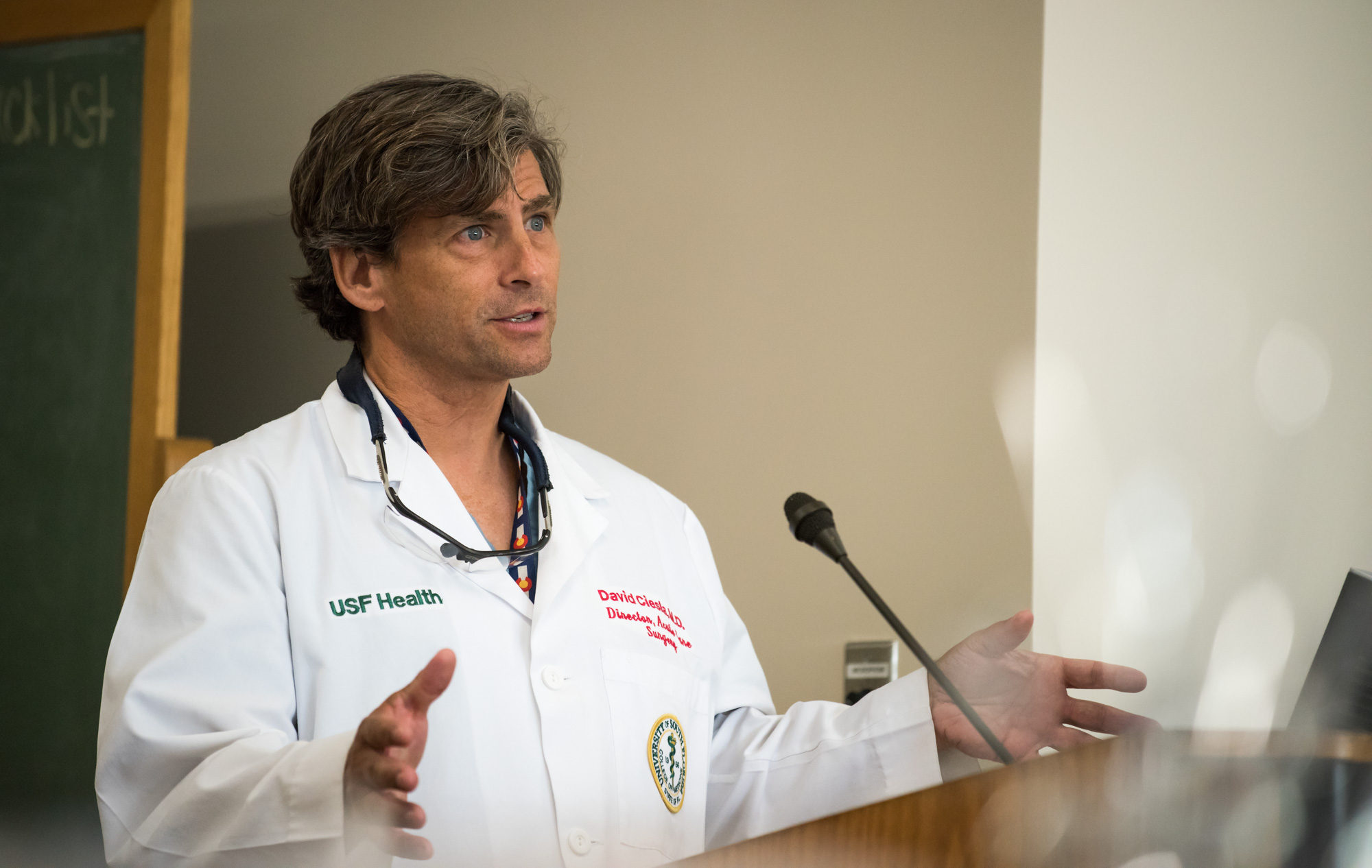 A male physician talking at the trauma awareness luncheon