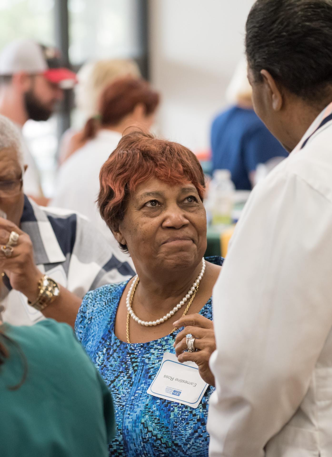 Male physician talking with a female patient at the fall rehab reunion