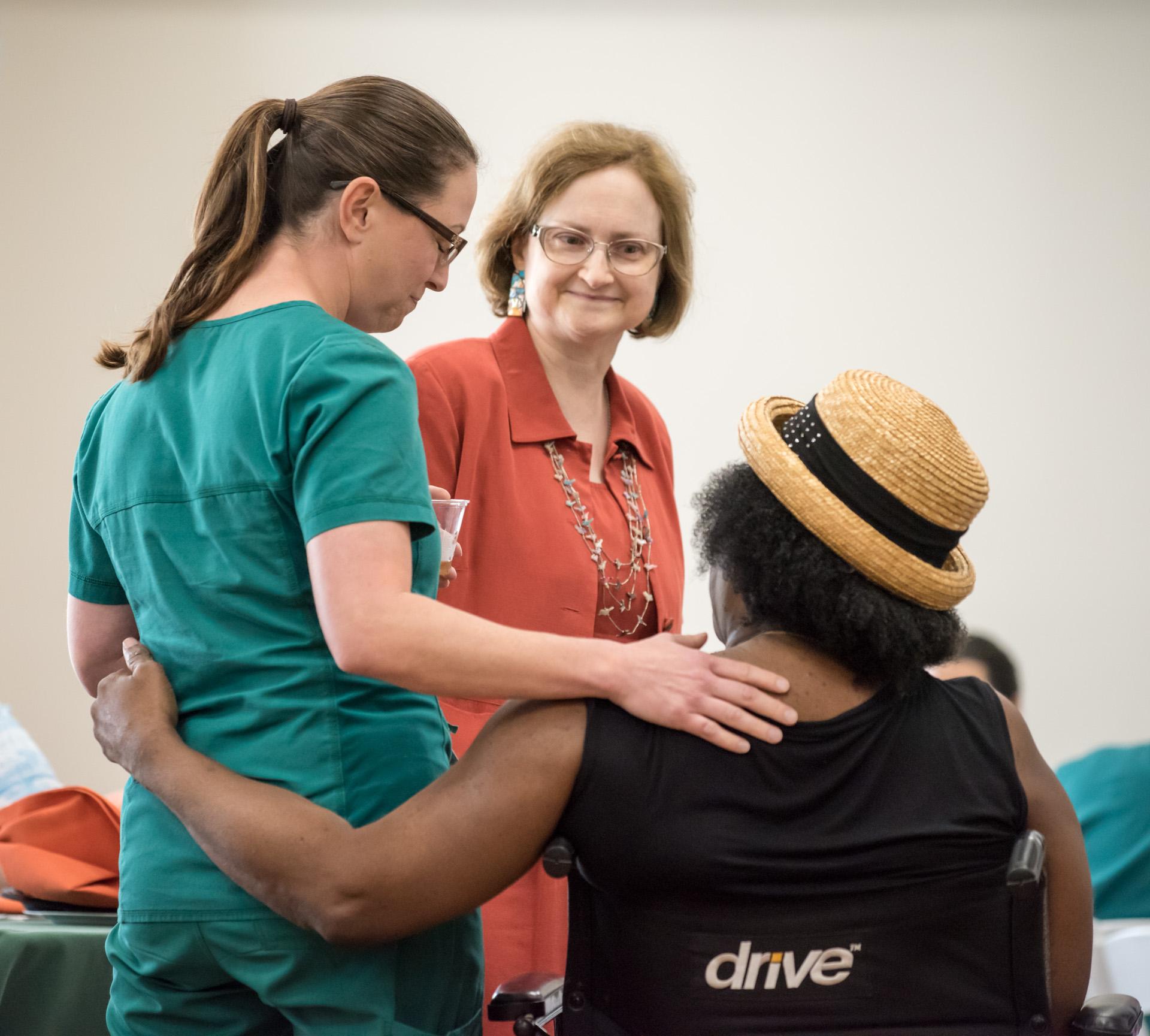 Three women talking at the fall rehab reunion