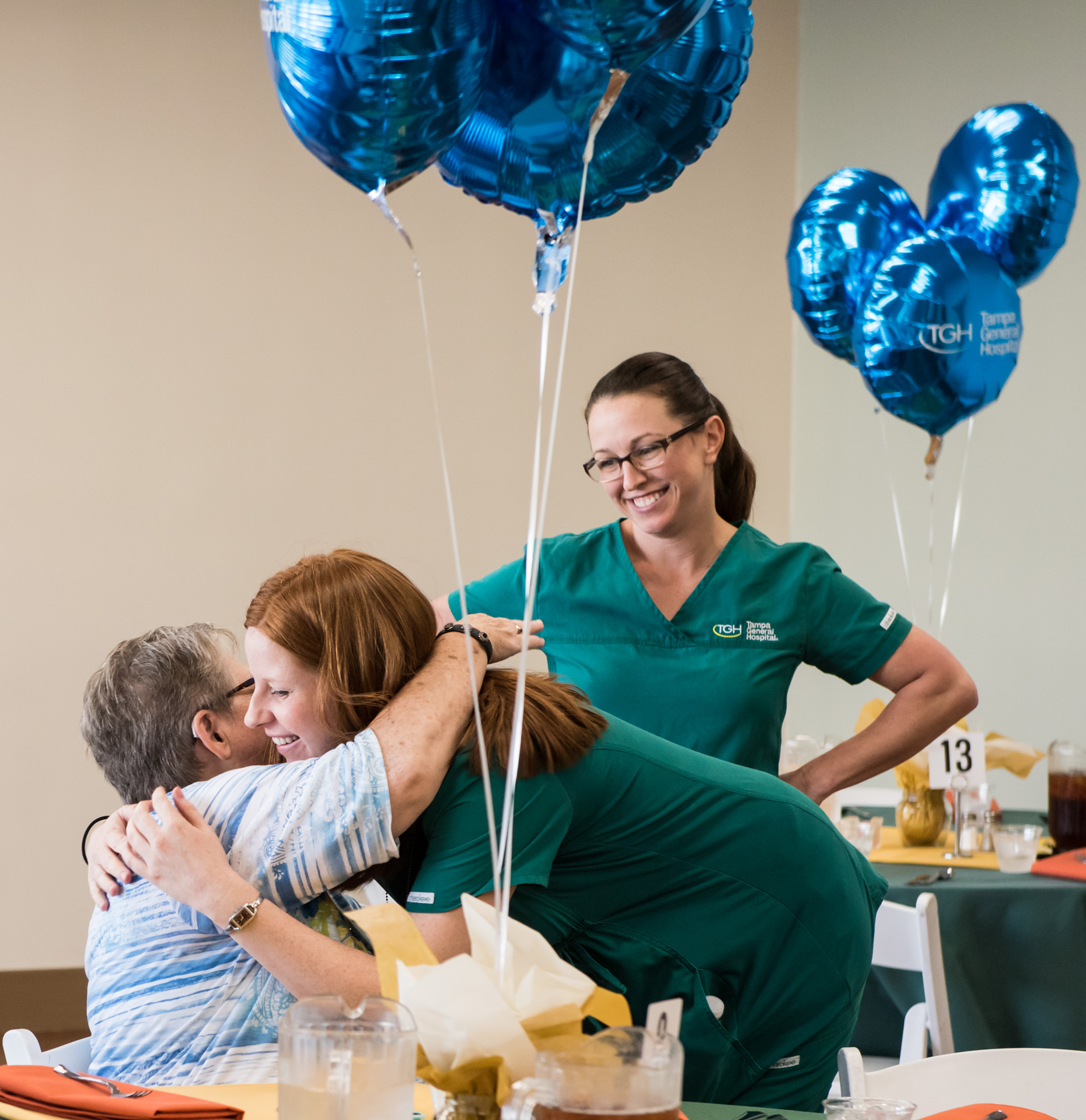 female physician hugging a female patient at the fall rehab reunion