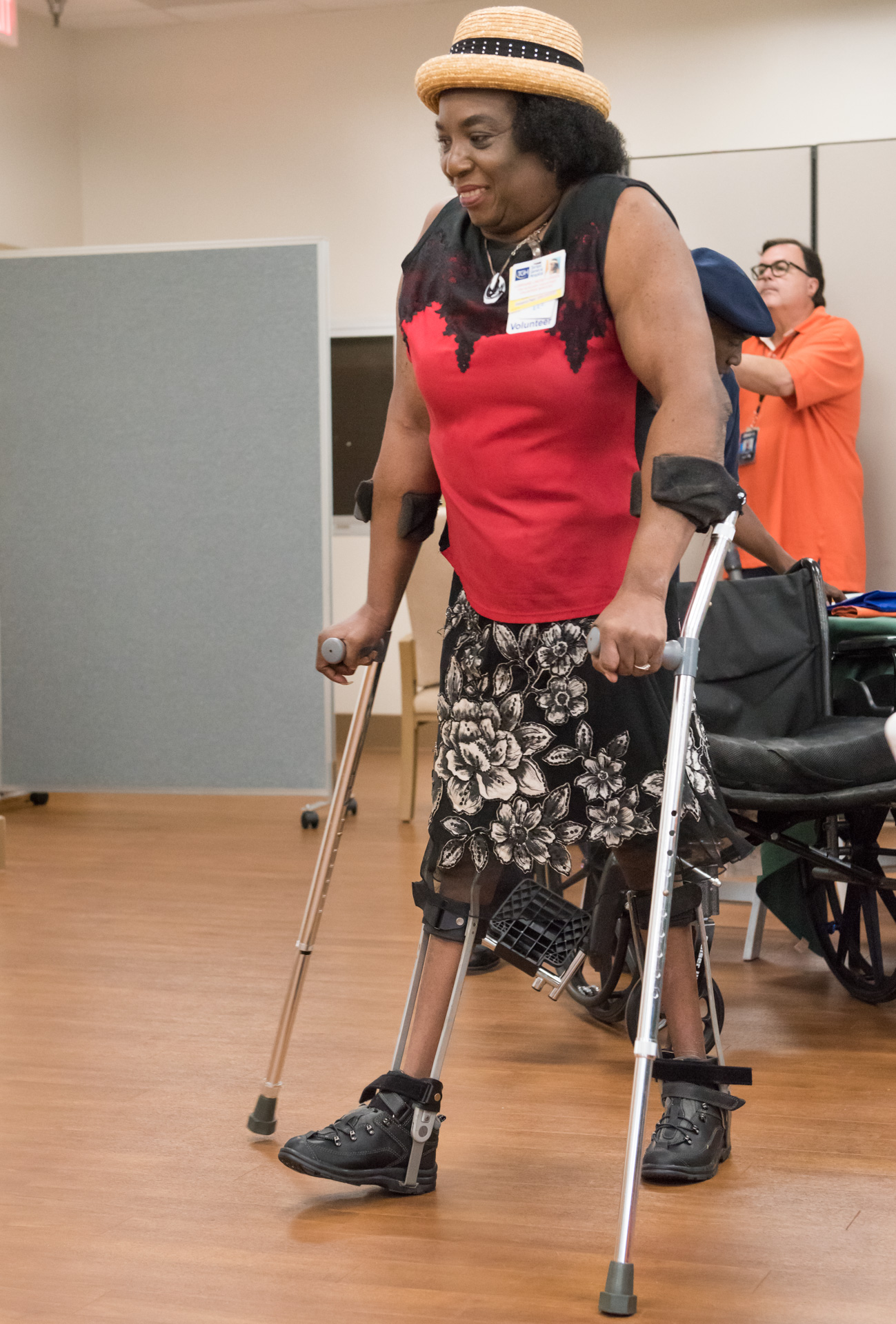 female patient walking at the fall rehab reunion