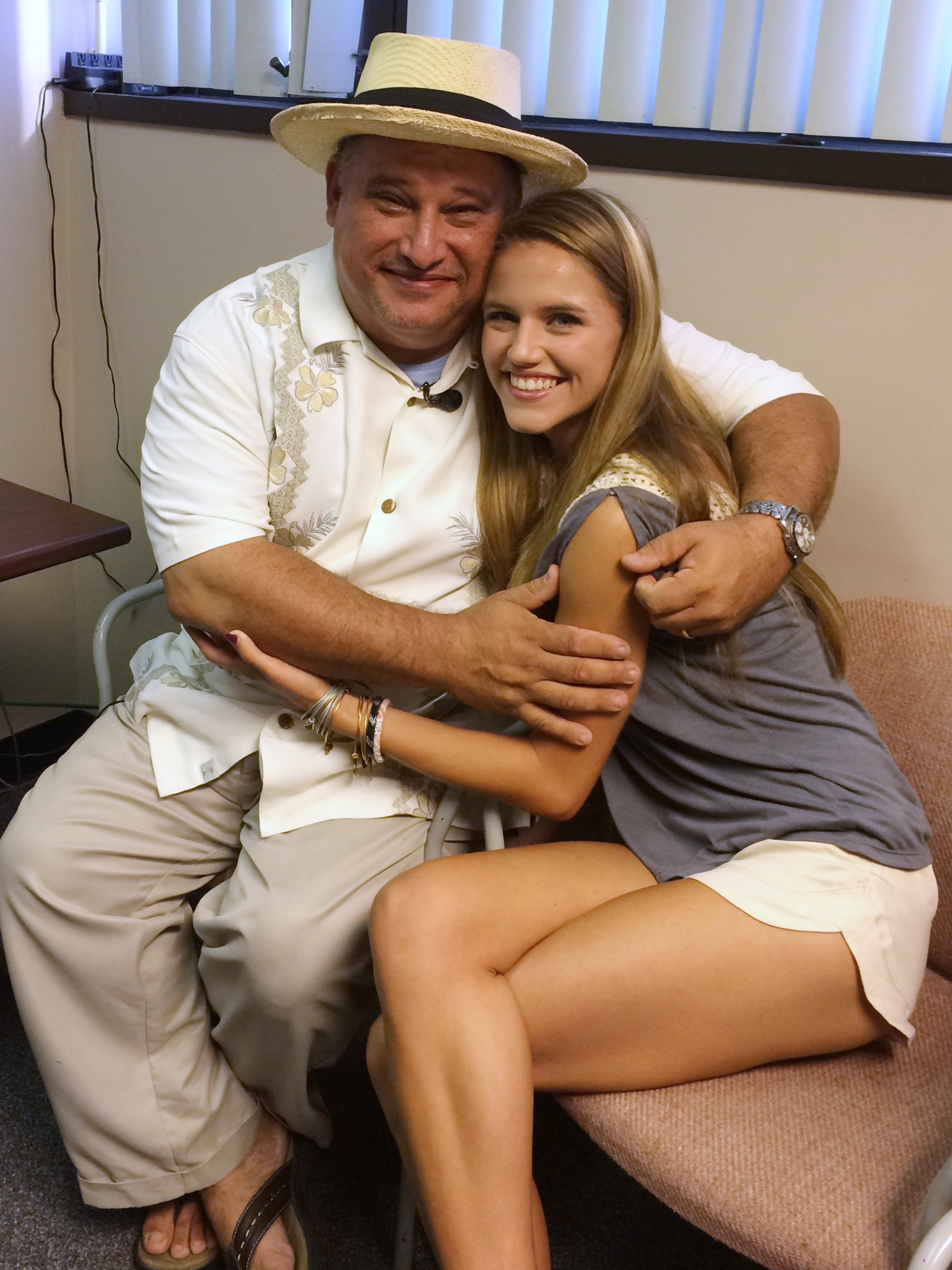 "Davelis ""D.C."" Goutoufas and his daughter Olivia, 17, just before the process to turn on the cochlear implants begins."