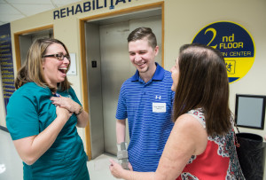 Tampa General Hospital speech therapist Lisa Stanley, left, sees former patient Ryan Mertens, 25, and his mom Jordan Mertens at the Rehabilitation Reunion.