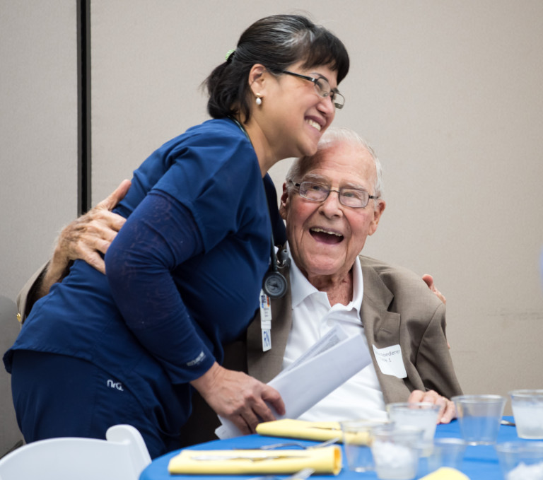 Clinical nurse Christina Pham hugs former patient Charlie Roederer at the reunion lunch.